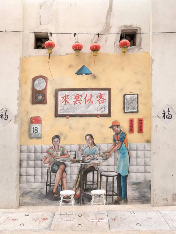 Street-ArIpoh Kaffee trinkende Menschen